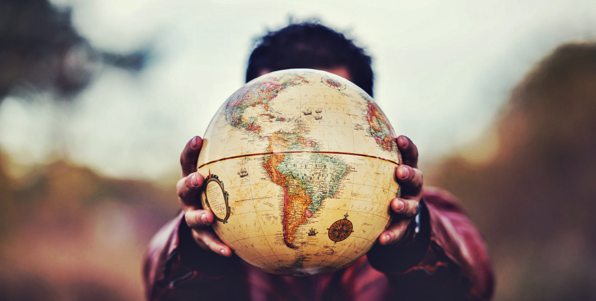 man holding a globe in his hands